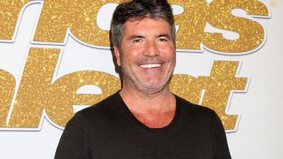 Simon Cowell back to work after breaking his back