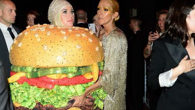 Katy Perry falls over dressed as hamburger