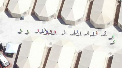 Drone footage shows 'tent city' immigration centre