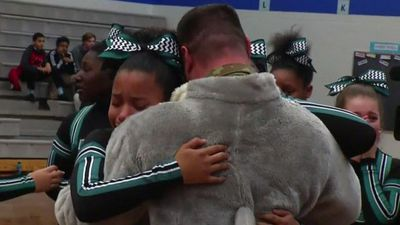 Dad surprises daughters as dolphin mascot