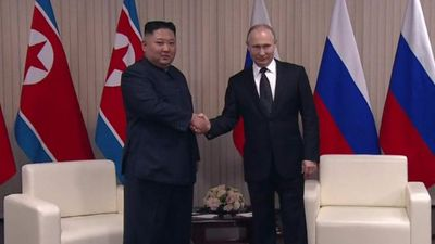 Putin and Kim shake hands for the first time