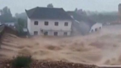 Buildings swept away in China typhoon