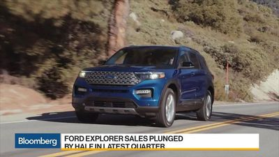 Ford Slashes Profit Outlook