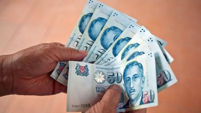 Singapore Dollar Further Weakness Expected, NAB's Tan Says