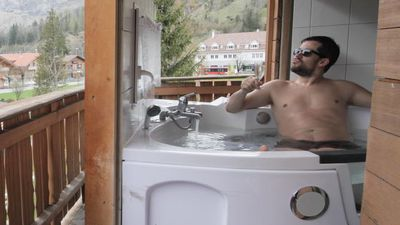 Soak in a transforming hot tub
