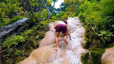 You can climb up this sticky waterfall in Thailand