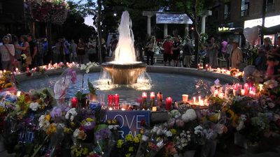 Mourners hold vigil for shooting victims in Toronto's Greektown