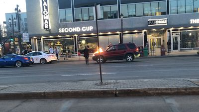 Video appears to show man dousing car in gasoline, lighting it on fire in Edmonton on Friday