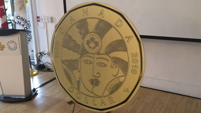 The Royal Canadian Mint unveils 'milestone' LGBTQ2 loonie, while protesters dispute the choice