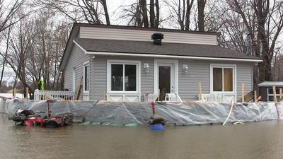 Homes in Rigaud, Que., sit in the water as spring flooding continues across the province