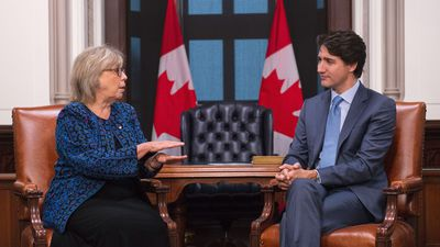 May urges Trudeau to go to climate summit as PM seeks common ground with Greens