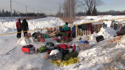 Protesters maintain blockade on rail line near Montreal for a second day