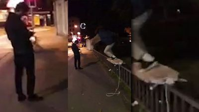 Man tries to use a ironing board as a skate board