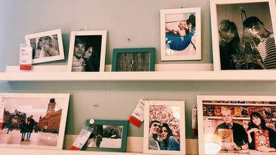 Couple Replaced 100 Framed Stock Photos At IKEA With Photos Of Themselves