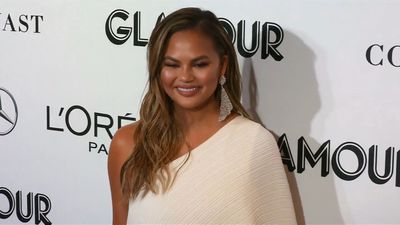 Chrissy Teigen's dad has her face tattooed on his arm