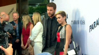 Miley Cyrus confirms marriage to Liam Hemsworth with wedding dress photo