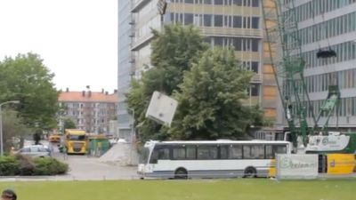 Cinder block falling on bus