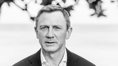 Daniel Craig on crutches after ankle surgery