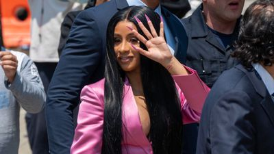 Cardi B performs in a bathrobe at Bonnaroo after unfortunate wardrobe malfunction