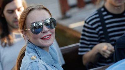 Lindsay Lohan urges journalists to report the news after 'Beach Club' drama
