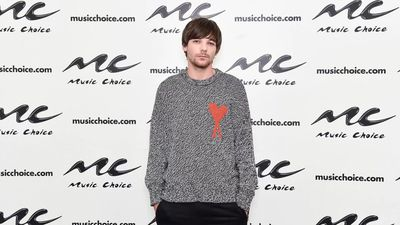 Louis Tomlinson struggled to connect with 'vague' One Direction music