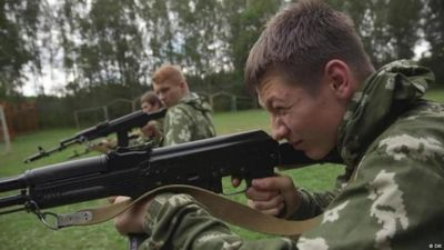 Russia's Youth Army play war at summer camp
