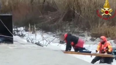 World News - Watch: Italian firefighters use planks of wood to rescue group from flooded river