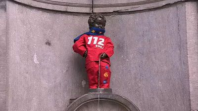 World News - Manneken Pis dons European Emergency Number Association costume for 112 Day