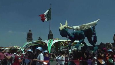 World News - Watch: Green dragons and dancing monkeys on parade for World Puppetry Day