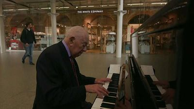 Piano player Denis, 91, spreads joy at London St Pancras station