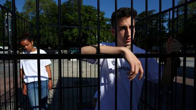Teens in cage protest US immigration policy in front of UN European headquarters