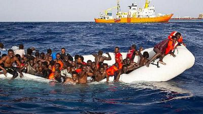 Caught in the act: people smugglers filmed transferring migrants at sea