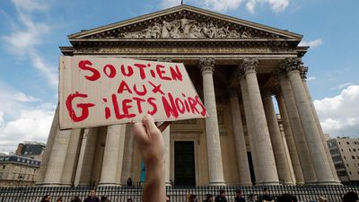 'Gilets Noirs' occupy Paris monument to protest migrants' rights in France