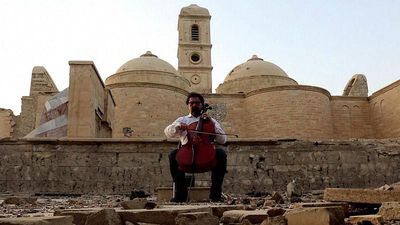 How is Iraqi cellist Karim Wasfi using music to fight terrorism?