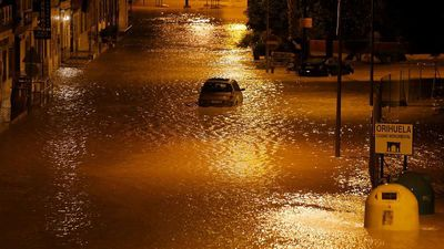 Spain braces for further flooding after two people swept away