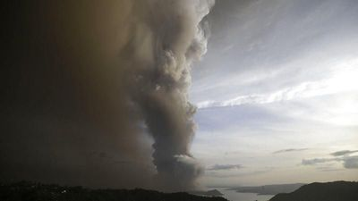 Thousands flee Taal volcano in Philippines as ash shuts Manila airport