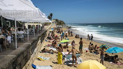 Crowds flock to Portugal's beaches as government eases coronavirus restrictions