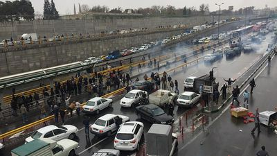 Iran's Revolutionary Guards threaten crackdown on protests as Internet is shut down