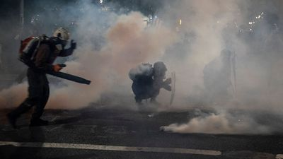 Portland protesters counter teargas with leaf blowers in standoff with federal troops