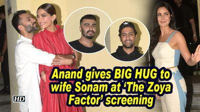 Anand Ahuja gives BIG HUG to wife Sonam at 'The Zoya Factor' screening
