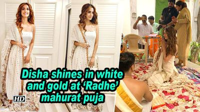 Disha patani shines in white and gold at radhe mahurat puja