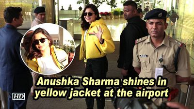 Anushka sharma shines in yellow jacket at the airport