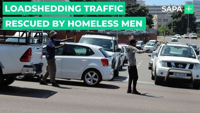 Loadshedding traffic rescued by homeless men