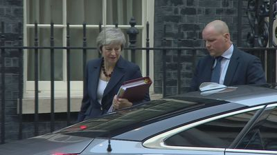 Prime Minister Theresa May heads to Parliament for PMQs