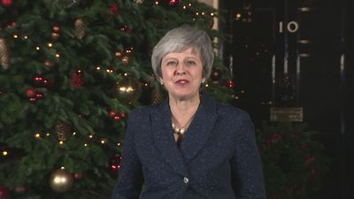 Theresa May promises to listen after winning confidence vote