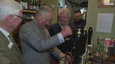 Prince Charles pulls pints and plays darts in Gloucestershir