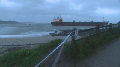 Russian cargo ship runs aground in Cornwall in stormy seas