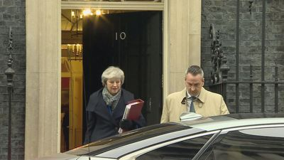 Theresa May departs Downing Street