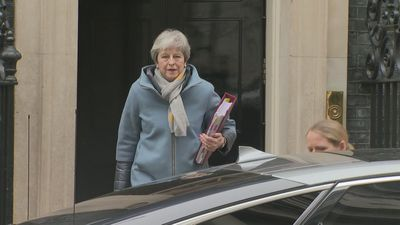 Theresa May departs 10 Downing Street for PMQs