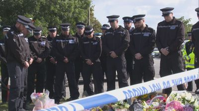 Police officers visit PC Harper's murder scene
